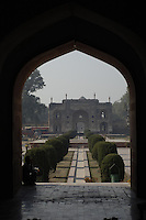 Looking back from under one of the arches of the main building of the Emperor Jahangir's Tomb in Lahore towards the entrance and, behind it, the mausoleum of Nur Jahan.