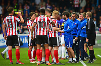 Lincoln City manager Danny Cowley, left, issues instructions to his players during a break in play<br /> <br /> Photographer Andrew Vaughan/CameraSport<br /> <br /> The EFL Sky Bet League Two Play Off First Leg - Lincoln City v Exeter City - Saturday 12th May 2018 - Sincil Bank - Lincoln<br /> <br /> World Copyright &copy; 2018 CameraSport. All rights reserved. 43 Linden Ave. Countesthorpe. Leicester. England. LE8 5PG - Tel: +44 (0) 116 277 4147 - admin@camerasport.com - www.camerasport.com