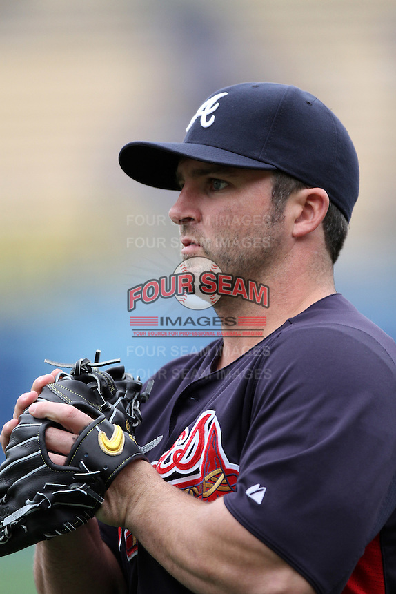 Dan Uggla #26 of the Atlanta Braves before a game against the Los Angeles Dodgers at Dodger Stadium on April 24, 2012 in Los Angeles,California. Los Angeles defeated Baltimore 6-3.(Larry Goren/Four Seam Images)