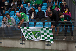 Home fans tying a banner to the front of the stand before kick-off as Guernsey take on Corinthian-Casuals in a Isthmian League Division One South match at Footes Lane. Formed in 2011, Guernsey FC are a community club located in St. Peter Port on the island of Guernsey and were promoted to the Isthmian League Division One South in 2013. The visitors from Kingston upon Thames won the fixture by 1-0, watched by a crowd of 614 spectators.