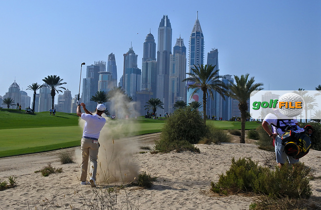 Bryson Dechambeau (USA) in the sand on the 8th during Round 3 of the Omega Dubai Desert Classic, Emirates Golf Club, Dubai,  United Arab Emirates. 26/01/2019<br /> Picture: Golffile | Thos Caffrey<br /> <br /> <br /> All photo usage must carry mandatory copyright credit (&copy; Golffile | Thos Caffrey)