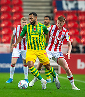 4th November 2019; Bet365 Stadium, Stoke, Staffordshire, England; English Championship Football, Stoke City versus West Bromwich Albion; Matt Phillips of West Bromwich Albion under pressure from Sam Clucas of Stoke City - Strictly Editorial Use Only. No use with unauthorized audio, video, data, fixture lists, club/league logos or 'live' services. Online in-match use limited to 120 images, no video emulation. No use in betting, games or single club/league/player publications