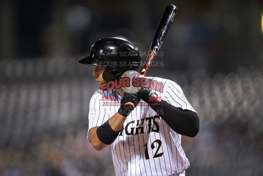 Ramon Torres (12) of the Charlotte Knights at bat against the Scranton/Wilkes-Barre RailRiders at BB&T BallPark on August 13, 2019 in Charlotte, North Carolina. The Knights defeated the RailRiders 15-1. (Brian Westerholt/Four Seam Images)