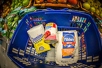 Domino sugar, Comstock pie filling and Pillsbury flour hang out in a shopping basket in a supermarket in New York on Tuesday, December 9, 2014.  (© Richard B. Levine)