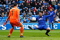 Sean Morrison of Cardiff City attempts to chip keeper Stephen Bywater of Burton Albion during the Sky Bet Championship match between Cardiff City and Burton Albion at the Cardiff City Stadium, Wales, UK. Friday 30 March 2018