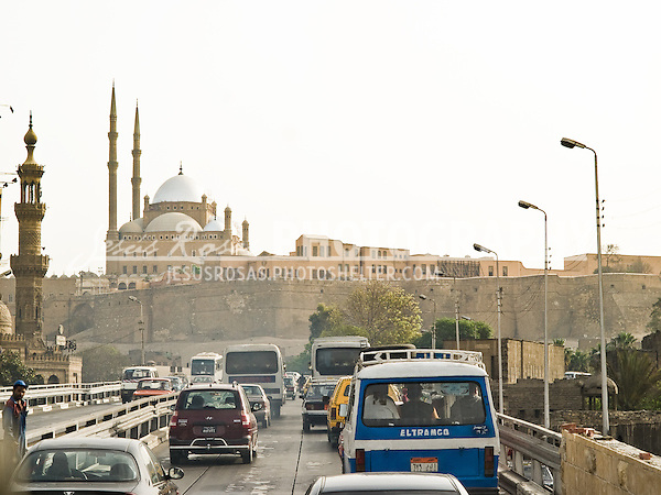 Traffic at the frontground and the Citadel of Salah Al-Din at the background. Cairo, Egypt. Year: 2009.