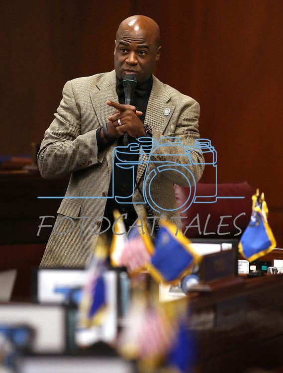 Nevada Sen. Kelvin Atkinson, D-North Las Vegas, works on the Senate floor at the Legislative Building, in Carson City, Nev., on Friday, Feb. 20, 2015. <br /> Photo by Cathleen Allison