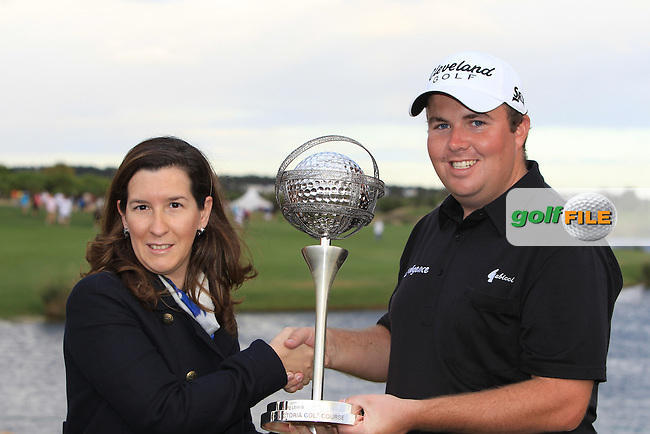 Cecilia Meireles Secretary of State for Tourism presents the winner Shane Lowry (IRL) with the trophy at the end of Sunday's Final Round of the Portugal Masters at the Oceanico Victoria Golf Course, Vilamoura, Portugal 14th October 2012 (Photo Eoin Clarke/www.golffile.ie)