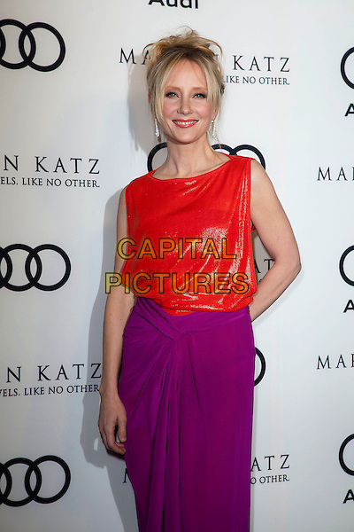 Anne Heche.Audi And Martin Katz Kick Off Golden Globes Week 2012 Held At Cecconi's Restaurant, West Hollywood, California, USA..January 8th, 2012.half length red pink purple dress shiny sleeveless top skirt hand on hip.CAP/ADM/ES.©Emiley Schweich/AdMedia/Capital Pictures.