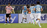 Calcio, Serie A: Lazio vs Palermo. Roma, stadio Olimpico, 2 settembre 2012..Lazio forward Miroslav Klose, of Germany, second from left, celebrates with teammates after scoring as Palermo defender Santiago Garcia, of Argentina, left, reacts, during the Italian Serie A football match between Lazio and Palermo at Rome's Olympic stadium, 2 September 2012..UPDATE IMAGES PRESS/Riccardo De Luca
