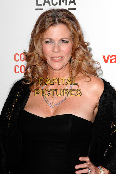 """RITA WILSON.The West Coast premiere of """"Valentino: The Last Emperor"""" at the Los Angeles County Museum of Art (LACMA), Los Angeles, California, USA..April 1st, 2009.half length black dress hand on hip cleavage diamond necklace .CAP/ROT.©Lee Roth/Roth Stock/Capital Pictures"""