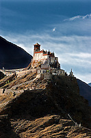 The Yumbulagang fortress rises from the summit of Mt. Tashitseri on the eastern bank of the Yarlung Tsangpo like a medieval European castle. The lower chapel is a celebration of the ancient Yarlung Kings and the upper chapel has a wall of Buddhist scriptures and an image of Chenresig (Avalokiteshvara - the Bodhisattva of Compassion)..