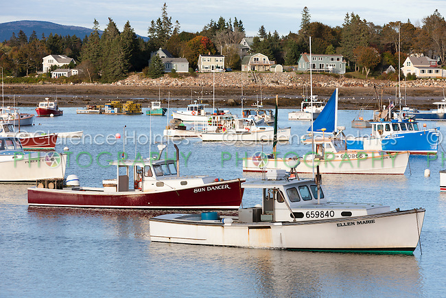 Lobster boats sit at anchor in Bass Harbor in Tremont, Maine.