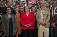 """Veranstaltung """"50 Jahre Entwicklungshelfer-Gesetz – 'Die Welt im Gepaeck'"""" am Freitag den 12. Juli 2019 in der Berliner St. Elisabethkirche.<br /> Als Gast war die Bundeskanzlerin Angela Merkel geladen.<br /> Den Ehrentag fuer zurueckgekehrte Entwicklungshilfe-Fachkraefte veranstalten die Gemeinsame Konferenz Kirche und Entwicklung (GKKE) und die Arbeitsgemeinschaft der Entwicklungsdienste (AGdD).<br /> Im Bild 1. Reihe vlnr.: Judith Ohene, AGdD; Cornelia Fuellkrug-Weitzel, Brot fuer die Welt; Bundeskanzelrin Angela Merkel.<br /> 12.7.2019, Berlin<br /> Copyright: Christian-Ditsch.de<br /> [Inhaltsveraendernde Manipulation des Fotos nur nach ausdruecklicher Genehmigung des Fotografen. Vereinbarungen ueber Abtretung von Persoenlichkeitsrechten/Model Release der abgebildeten Person/Personen liegen nicht vor. NO MODEL RELEASE! Nur fuer Redaktionelle Zwecke. Don't publish without copyright Christian-Ditsch.de, Veroeffentlichung nur mit Fotografennennung, sowie gegen Honorar, MwSt. und Beleg. Konto: I N G - D i B a, IBAN DE58500105175400192269, BIC INGDDEFFXXX, Kontakt: post@christian-ditsch.de<br /> Bei der Bearbeitung der Dateiinformationen darf die Urheberkennzeichnung in den EXIF- und  IPTC-Daten nicht entfernt werden, diese sind in digitalen Medien nach §95c UrhG rechtlich geschuetzt. Der Urhebervermerk wird gemaess §13 UrhG verlangt.]"""