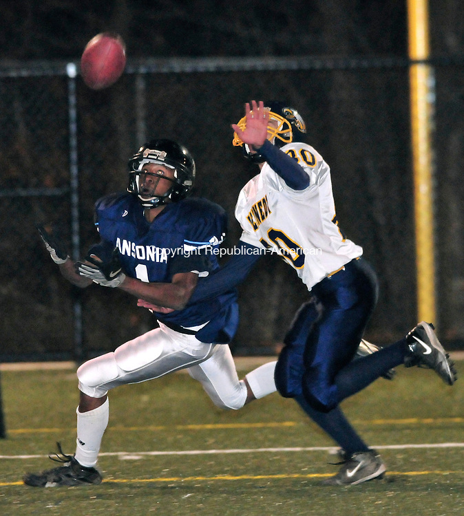WATERBURY, CT-20 NOVEMBER 2008 --112008JS05--Ansonia's Tyrell Moore (1) can't pull in a pass in the endzone as Kennedy's Justin Velasquez (80) defends during their game Thursday at Municipal Stadium in Waterbury. <br /> Jim Shannon / Republican-American