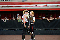 Sun Prairie pitcher, Maddie Gardner, talks to catcher, Chloe Knoernschild at the top of the sixth inning Saturday night. Oshkosh North goes on to win 4-2 in nine innings to win the championship game of the 2019 Division 1 Wisconsin WIAA girls state high school softball tournament on June 8 at Goodman Diamond in Madison, Wisconsin