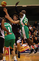 Heat forward Dillon Boucher lays a shot up under pressure from Richard Jeter during the NBL match between Manawatu Jets and Harbour Heat at Arena Manawatu, Palmerston North, New Zealand on Saturday 17 April 2010. Photo: Dave Lintott / lintottphoto.co.nz