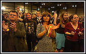 SECC Glasgow election count - less than gracious response from two SNP supporters (right) as SSP supporters - including Tommy Sheridans wife, Gail (centre) - applaud ... Picture by Donald MacLeod 01.05.03