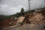 Palestinians try to access their village during the closure of the entrance to the villages of Tel and Iraq Burin near the West Bank city of Nablus, on March 3, 2016. Israeli forces closed all roads leaving Nablus city and shut the entrances to nearby villages after two Israeli soldiers were stabbed and injured in an attack near the Burin village in southern Nablus Wednesday evening, the Palestinian military liaison office said. Photo by Nedal Eshtayah