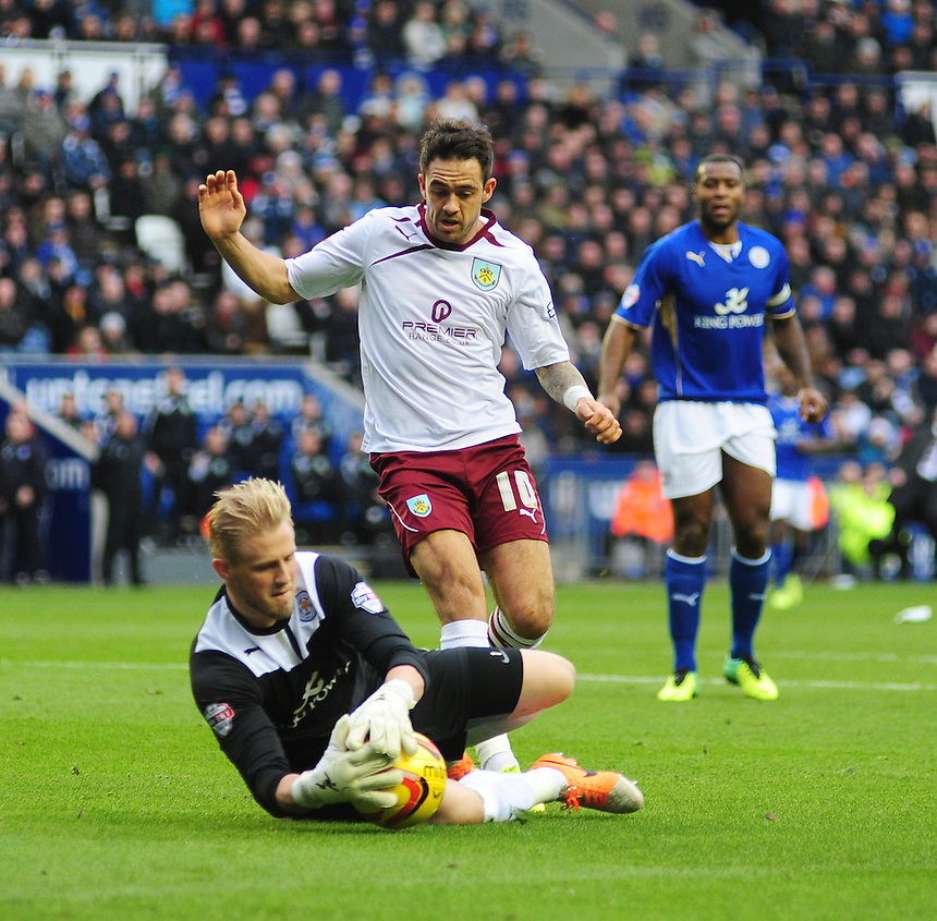 Leicester City's Kasper Schmeichel makes a save at the feet of Burnley's Danny Ings <br /> <br /> Photo by Chris Vaughan/CameraSport<br /> <br /> Football - The Football League Sky Bet Championship - Leicester City v Burnley - Saturday 14th December 2013 - King Power Stadium - Leicester<br /> <br /> &copy; CameraSport - 43 Linden Ave. Countesthorpe. Leicester. England. LE8 5PG - Tel: +44 (0) 116 277 4147 - admin@camerasport.com - www.camerasport.com