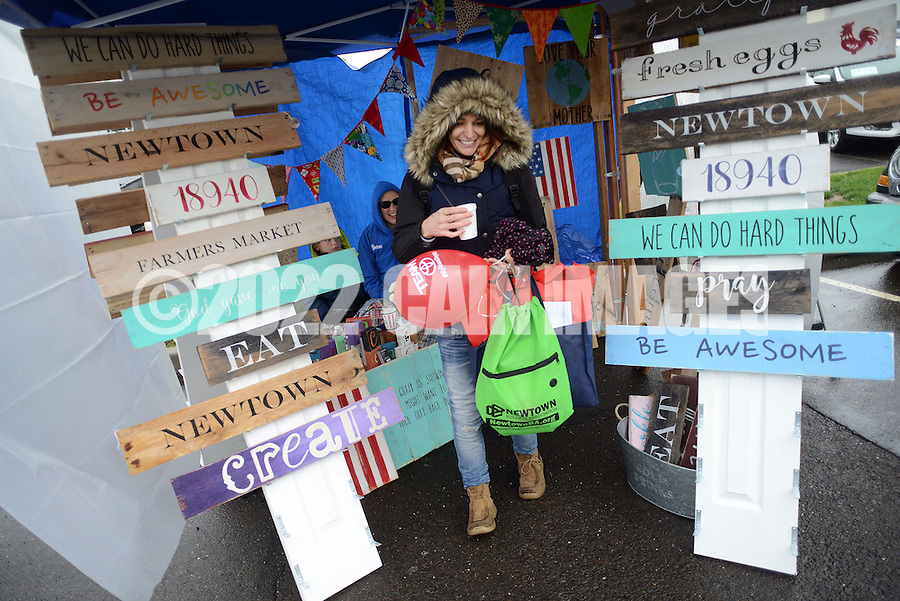 Lizzie Wickham of Newtown, Pa. looks at some custom signs for sale during the Newtown Business Association's Welcome Day Sunday May 1, 2016 in Newtown, Pennsylvania.  (Photo by William Thomas Cain)