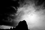 Storm clouds gather over the Temple Of The Sun rock formation.  Capital Reef National Park, Utah.