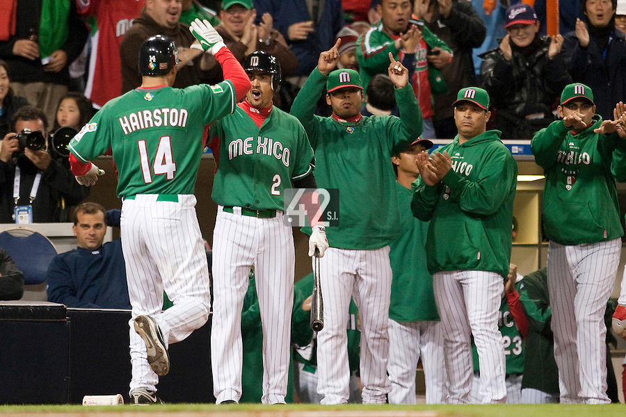 15 March 2009: #14 Scott Hairston of Mexico is congratulated by teammates after scoring during the 2009 World Baseball Classic Pool 1 game 2 at Petco Park in San Diego, California, USA. Korea wins 8-2 over Mexico.