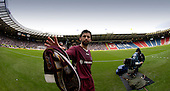 Tennents Scottish Cup - Semi Final at Hampden Park, Glasgow - Hibs V Hearts - Paul Hartley leaves the field, with Hampden half-full, or half empty.... Picture by Donald MacLeod 01.04.06