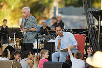 "San Antonio mayor Julián Castro reads to children from the book, ""Charlie Parker Played Be Bop"" during the KRTU ""Year of Jazz"" Festival, Sunday, Oct. 23, 2011, at Sunken Garden Theater in San Antonio, Texas, USA. (Darren Abate/pressphotointl.com)"