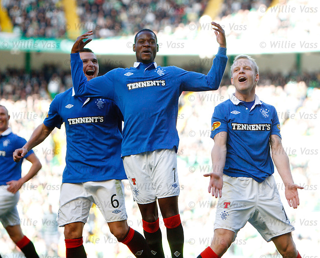Steven Naismith, Maurice Edu and Lee McCulloch whoop it up as Kenny Miller seals a 3-1 victory