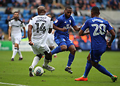 30th September 2017, Cardiff City Stadium, Cardiff, Wales; EFL Championship football, Cardiff City versus Derby County; Andre Wisdom of Derby County passes the ball upfield as he is approached by Junior Hoilett of Cardiff City