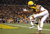 PITTSBURGH, PA - DECEMBER 08:  William Gay #22 of the Pittsburgh Steelers intercepts a pass by in front of Mohamed Massaquoi #11 of the Cleveland Browns during the game on December 8, 2011 at Heinz Field in Pittsburgh, Pennsylvania.  (Photo by Jared Wickerham/Getty Images)