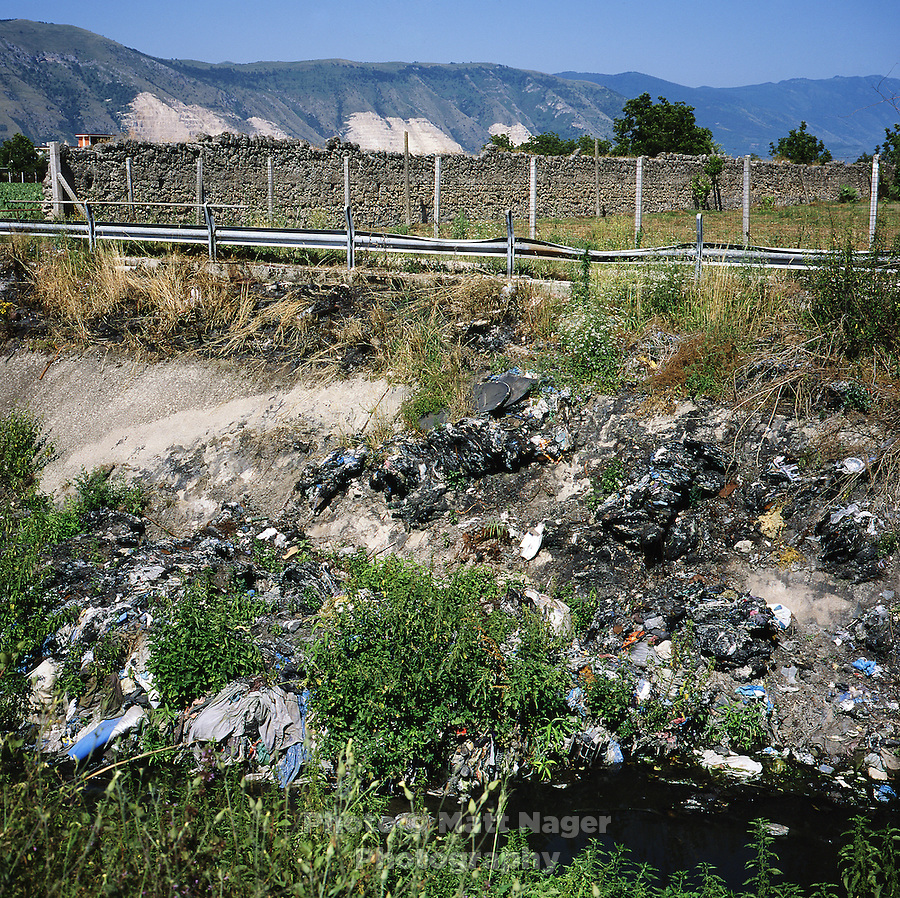 Piles of illegally disposed televisions, computers, trash, and toxic waste lie abandoned next to an irrigation canal for local farms near Marigliano, Italy. Piles of urban waste can be found throughout the provinces of Naples and Caserta. Surrounding farms have seen a drop in production quality of produce...PHOTOS/ MATT NAGER