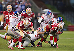 New York Giants defense gang tackles San Francisco 49ers running back Frank Gore (21) during an NFC Championship NFL football game on January 22, 2012 in San Francisco, California. The Giants won 20-17 in overtime. (AP Photo/David Stluka)