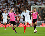 Leigh Griffiths of Scotland tussles with John Stones of England during the FIFA World Cup Qualifying Group F match at Wembley Stadium, London. Picture date: November 11th, 2016. Pic David Klein/Sportimage