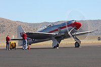Ground crews perform a test run of the Unlimited Air Racer Dreadnought during the 2010 Reno National Championship Air Races. Dreadnought is a modified Hawker Sea Fury.
