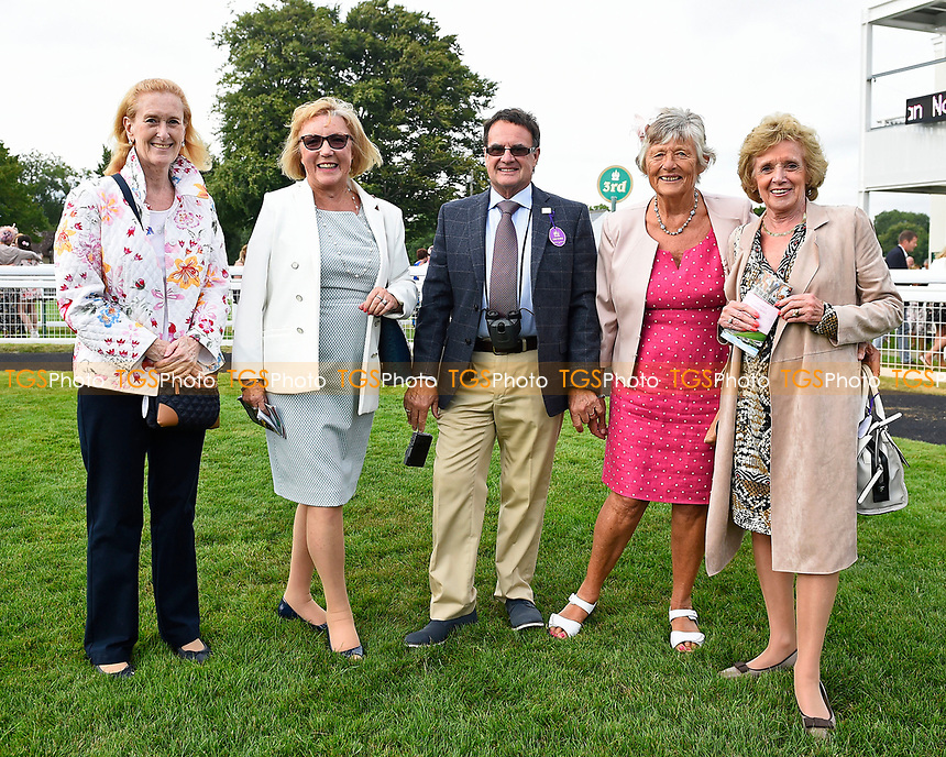 Connections of Exceeding Power in the winners enclosure after winning The Total Decor Ltd Handicap,  during Ladies Evening Racing at Salisbury Racecourse on 15th July 2017