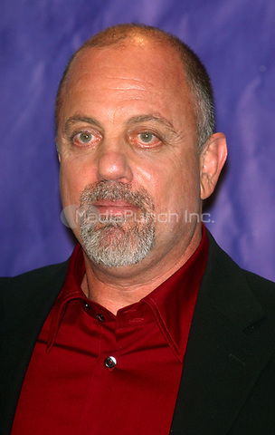 BILLY JOEL 03/10/2003<br /> THE 18TH ANNUAL ROCK AND ROLL HALL OF  FAME INTRODUCTION DINNER AT THE  WALDORF ASTORIA HOTEL IN  NEW YORK CITY<br /> Photo By John Barrett/PHOTOlink/MediaPunch