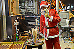 An Egyptian waiter wears Santa Claus costume as he works as part of Christmas and New Year festivities, in Cairo on December 31, 2014. Photo by Amr Sayed