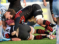 Hendon, England. Nick Fenton-Wells of Saracens nose down during the LV= Cup match for the first professional rugby game on the artificial turf pitch made for rugby between Saracens and Cardiff Blues at Allianz Park Stadium on January 27, 2013 in Hendon, England.
