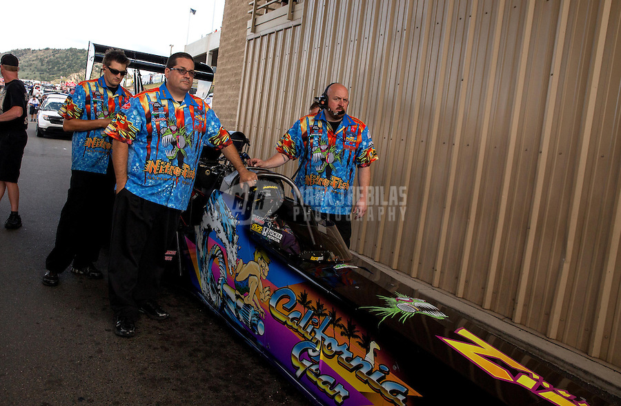 Jul. 19, 2013; Morrison, CO, USA: NHRA crew members for top fuel dragster driver Steve Chrisman during qualifying for the Mile High Nationals at Bandimere Speedway. Mandatory Credit: Mark J. Rebilas-