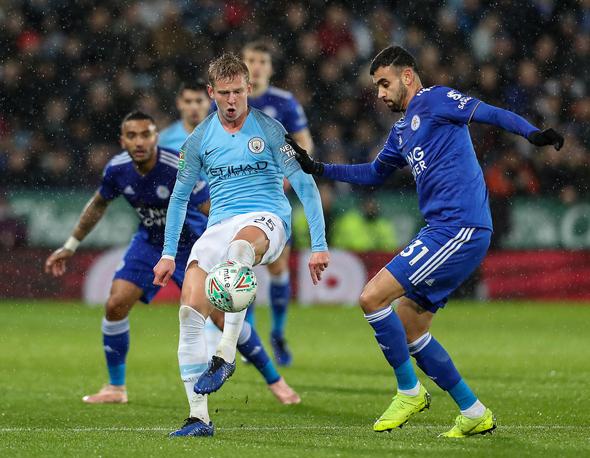 Manchester City 's Oleksandr Zinchenko under pressure from Leicester City's Rachid Ghezzal<br /> <br /> Photographer Andrew Kearns/CameraSport<br /> <br /> English League Cup - Carabao Cup Quarter Final - Leicester City v Manchester City - Tuesday 18th December 2018 - King Power Stadium - Leicester<br />  <br /> World Copyright © 2018 CameraSport. All rights reserved. 43 Linden Ave. Countesthorpe. Leicester. England. LE8 5PG - Tel: +44 (0) 116 277 4147 - admin@camerasport.com - www.camerasport.com