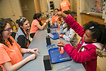 Camille Johnson, 9, plays with gas, a slime made of glue and borax, as Abbey Jackson, a third-year chemistry grad student, looks on during FEMMES (Females Excelling More in Math, Engineering, and Science) Capstone event. The event was a free, annual one-day outreach program introducing young women from Durham (4th through 6th grade) to math, science and engineering. <br /> The goal of FEMMES (Females Excelling More in Math, Engineering and Science) is to give girls hands-on experience in fields where women are often greatly under-represented. By using female volunteers and faculty members, we hope to demonstrate that women can and do excel in these fields. Each faculty volunteer directs a hands-on activity that shows something interesting and fun about their area of expertise. Student volunteers lead groups to the activities and act as mentors for the day to our program&rsquo;s participants.