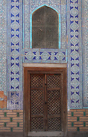Detail of doorway, Harem, Tash Khauli Palace, 1830-38, Khiva, Uzbekistan, Khiva, Uzbekistan, pictured on July 6, 2010, in the morning. Commissioned by Allah Kuli Khan the Tash Kauli palace is a huge complex containing 163 rooms which took its architects, Tajiddin and Kalandar, 10 years to build. The harem, occupying about half of the palace has 5 aiwan terraces, with delicately carved wooden pillars,  behind which were the quarters for the khan and his wives. Across the courtyard were the  concubines' apartments.  The facades and walls around the courtyards were decorated with traditional blue, ultramarine and white colours majolica made by Abdullah. Khiva, ancient and remote, is the most intact Silk Road city. Ichan Kala, its old town, was the first site in Uzbekistan to become a World Heritage Site(1991). Picture by Manuel Cohen.