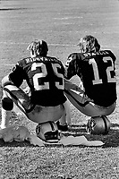 Oakland Raiders Fred Biletnikoff and Ken Stabler sitting on the sideline.(1971 photo by Ron Riesterer)