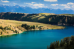 The deep aqua colors of the Flathead River below Flathead Lake near Polson, Montana
