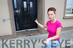 Michelle O'Brien points to the damage to the front door after an petrol bomb attack on her house last week in Ballyspillane Killarney