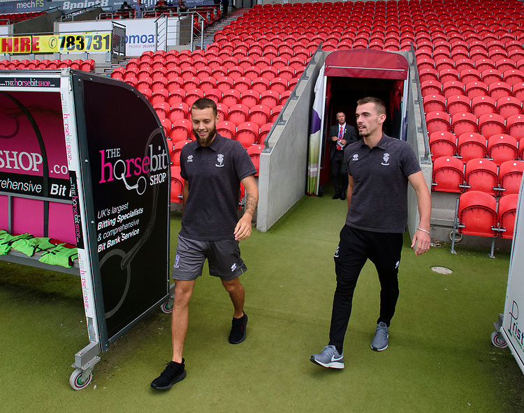 Lincoln City's Jorge Grant, left, and Harry Toffolo on arrival at Doncaster Rovers ground<br /> <br /> Photographer Andrew Vaughan/CameraSport<br /> <br /> EFL Leasing.com Trophy - Northern Section - Group H - Doncaster Rovers v Lincoln City - Tuesday 3rd September 2019 - Keepmoat Stadium - Doncaster<br />  <br /> World Copyright © 2018 CameraSport. All rights reserved. 43 Linden Ave. Countesthorpe. Leicester. England. LE8 5PG - Tel: +44 (0) 116 277 4147 - admin@camerasport.com - www.camerasport.com