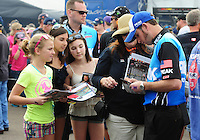 Mar. 10, 2012; Gainesville, FL, USA; NHRA top fuel dragster driver T.J. Zizzo signs autographs and greets fans during qualifying for the Gatornationals at Auto Plus Raceway at Gainesville. Mandatory Credit: Mark J. Rebilas-