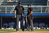 Umpires Thomas O'Neil (left) and Justin Juska chat between innings of the Appalachian League game between the Bristol Pirates and the Danville Braves at American Legion Post 325 Field on July 1, 2018 in Danville, Virginia. The Braves defeated the Pirates 3-2 in 10 innings. (Brian Westerholt/Four Seam Images)